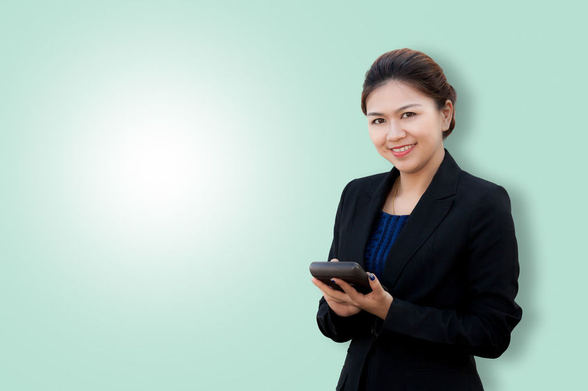 Portrait of business woman using calculator on color background with copy space Copy Space Employee Happiness Isolated Office Accountant Background Business Businesswoman Calculator Color Concept Consultant Digital Holding Looking Manager People Portrait Profit Secretary Smile Studio Shot Suit Technology