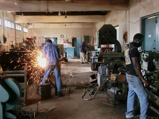 Suame, Kumasi, Ghana Ghana Kumasi Africa Suame Manatwork Metallic Workshop Sparks Sparks Fly Processing Working Working Hard AfricanStyle Traveling Travelphotography Eye4photography  EyeEm Best Shots Enjoying Life Hello World Check This Out At Work Iaeste Internship My Best Photo 2015 RePicture Growth