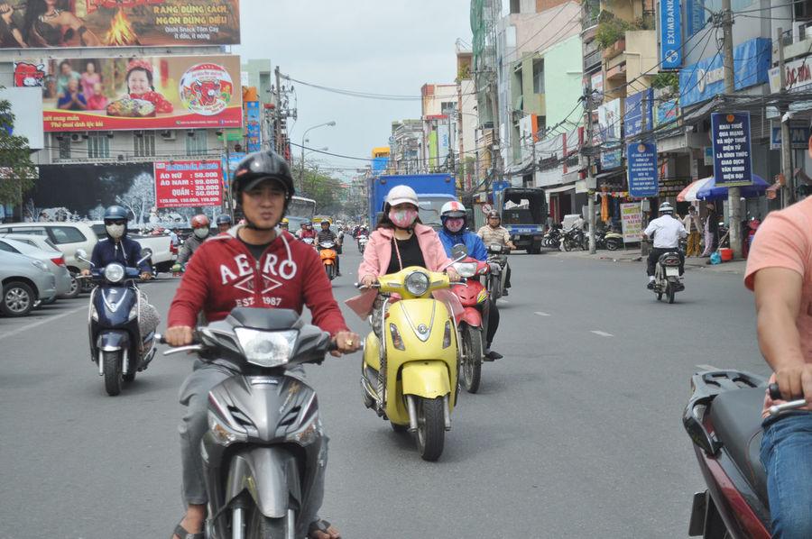 Light traffic in Da Nang, Vietnam. Casual Clothing City Life Da Nang Facemasks Helmets Lifestyle Motorbikes Motorcycles Motorscooters Outdoors Riders Riding Signs Traffic Transport Vietnam