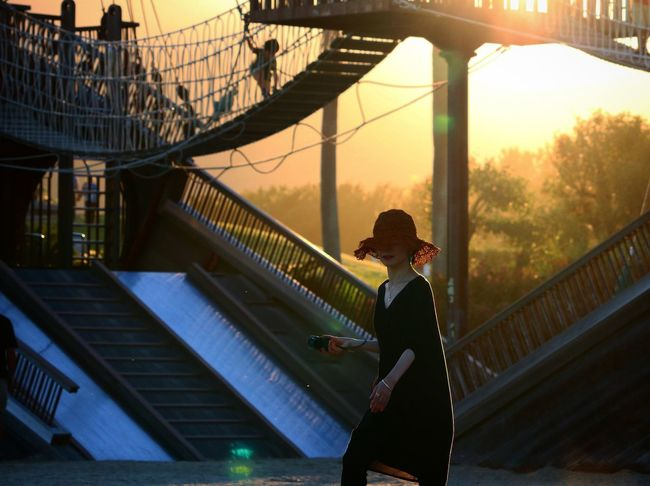 Bridge - Man Made Structure Adult People City One Person Women Only Women One Woman Only Adults Only Travel Destinations Standing Sunset Lifestyles Outdoors Sport Architecture Day Cityscape Sky Young Adult 広野公園 海岸 Japan Photos Amusement Park Ride Amusement Park