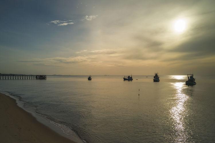 Sunrise at the shore of the sea at thap sakae, prachuap khiri khan, thailand
