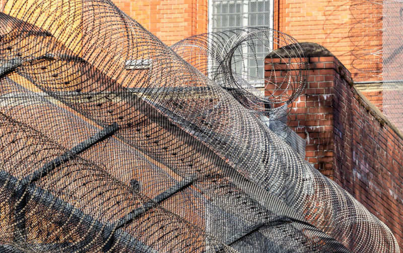 Barbed Wire Protection Security Secure Jailhouse Jail Prison Fence Wall - Building Feature Day Architecture Brick Wall Close-up No People Building Exterior Brick Outdoors Clothing Textile Wall Built Structure Pattern Industry Netting Glass Digital Composite