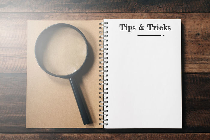 tips and tricks concept background with copy space Creativity Home Office SUPPORT Text Word Work Assist Concept Flat Lay Guide Help Info Information Magnifying Glass Notebook Quick Tips Solution Table Tips Tips And Tricks Tricks Useful Wooden Workspace