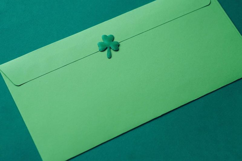 High angle view of paper against blue background