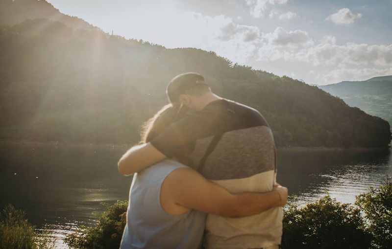 EyeEm EyeEm Best Shots EyeEm Selects EyeEm Gallery Adult Beauty In Nature Couple - Relationship Day Embracing Lake Leisure Activity Lens Flare Looking At View Men Nature Outdoors Positive Emotion Real People Scenics - Nature Standing Sunlight Togetherness Two People Water Young Men