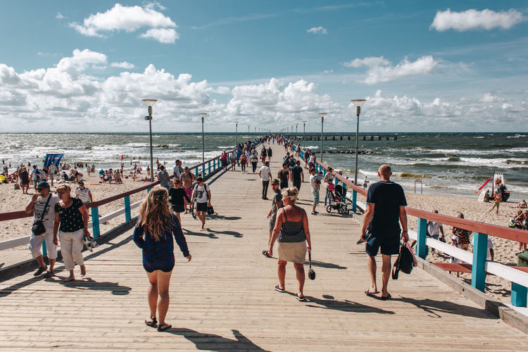 Lietuva Lithuania Adult Beach Bridge Cloud - Sky Crowd Day Group Of People Horizon Over Water Land Large Group Of People Leisure Activity Lifestyles Men Nature Outdoors Palanga Real People Sand Sea Sky Sunlight Water Women