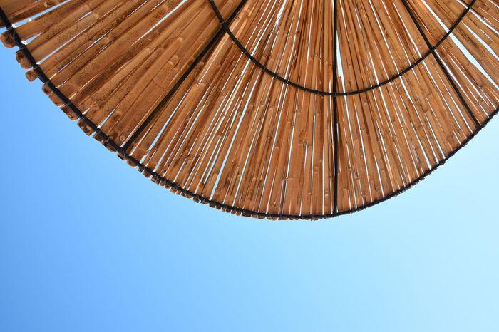 Beach sun umbrella made of bamboo. Beach sun umbrella textured background. Closeup texture of Bamboo sun umbrella. Background Bamboo Bamboo - Material Beach Beach Life Chill Out Close-up Detail Low Angel View Parasol Protection Relax Resort Rest Roof Rough Rustic Sky Sticks Straw Sun Sunbeam Sunflare Sunshade Umbrella