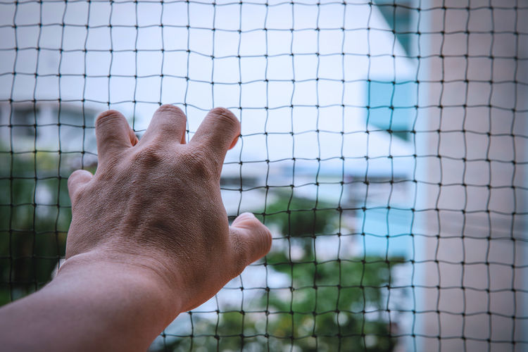 Barrier Body Part Boundary Close-up Day Fence Finger Focus On Foreground Hand Human Body Part Human Hand Leisure Activity Men Metal Nature One Person Outdoors Personal Perspective Real People Unrecognizable Person