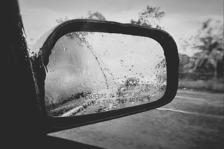 Objects in mirror... Rainy days is all we've been getting here in the tropics. But, there is nothing as perfectly mellowing as the sound, feel amd smell of rain. Relaxing Enjoying Life Rain Taking Photos