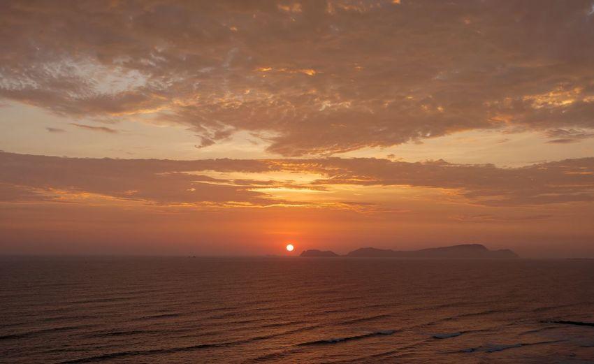 Sunset Sky Beauty In Nature Scenics - Nature Sunset Cloud - Sky Environment Landscape Sun Nature Land Tranquility Orange Color Outdoors Dramatic Sky Sea Sunlight No People Travel Idyllic