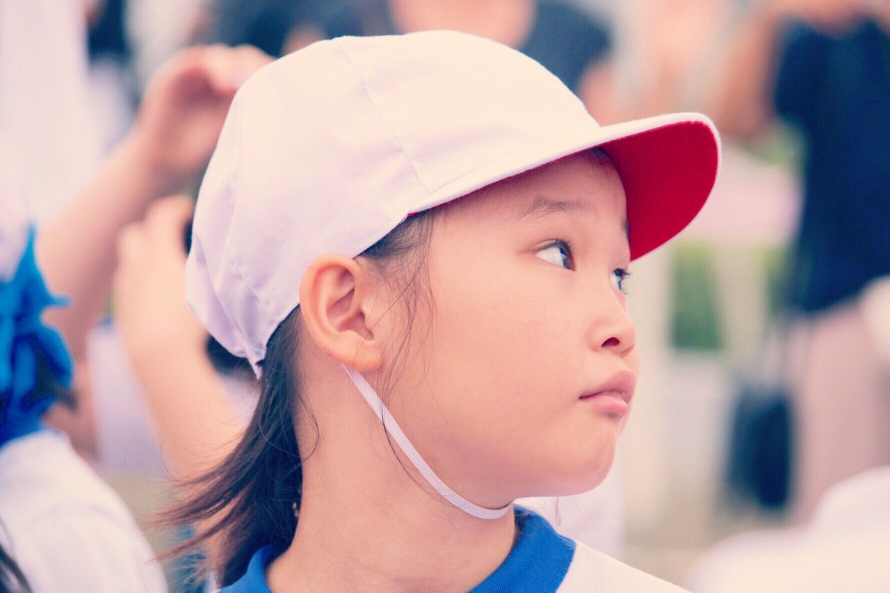 real people, focus on foreground, incidental people, childhood, headshot, leisure activity, lifestyles, cap, day, boys, young women, girls, outdoors, close-up, women, young adult, headwear