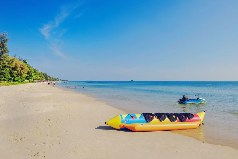A relaxing day on the beach. Freedom Beach Beauty In Nature Blue Clear Sky Day Holeday Horizon Over Water Jet Boat Multi Colored Nature Nautical Vessel Outdoors Sand Scenics Sea Sky Summer Sunlight Tourism Tranquil Scene Tranquility Vacations Water Yellow