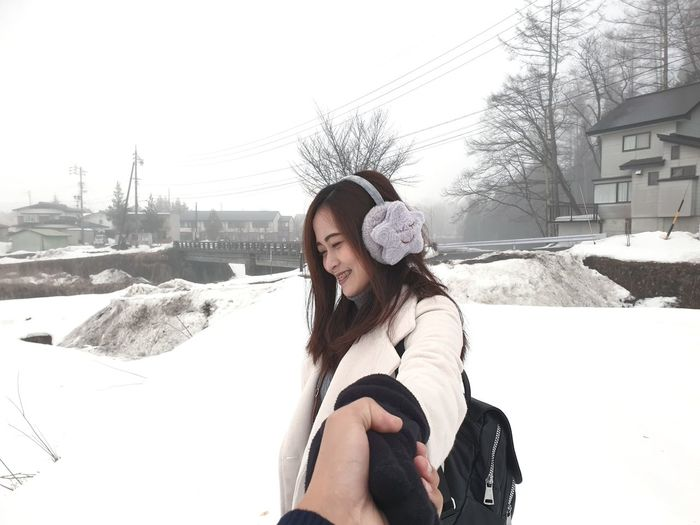Warm Clothing Snow Winter Young Women Cold Temperature Motion City Smiling Fun Front View