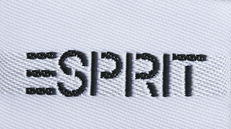 Corporate sign of a fashion company - Esprit Logo Brand Business Capital Letter Close-up Clothing Clothing Brand Company Corporate Business Embroidery Esprit Fashion International Logo No People Pattern Studio Shot Text Textile Textile Industry Texture Trademark Western Script White Background Worldwide Woven