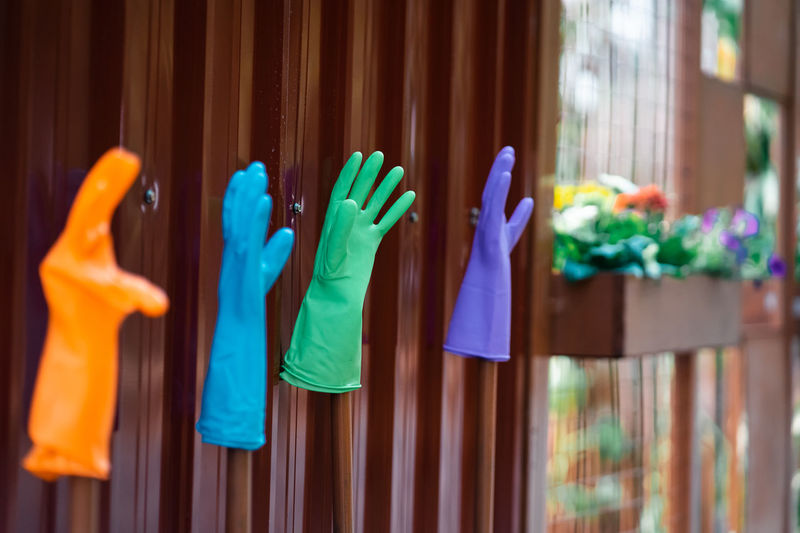 Colorful gloves on wooden wall