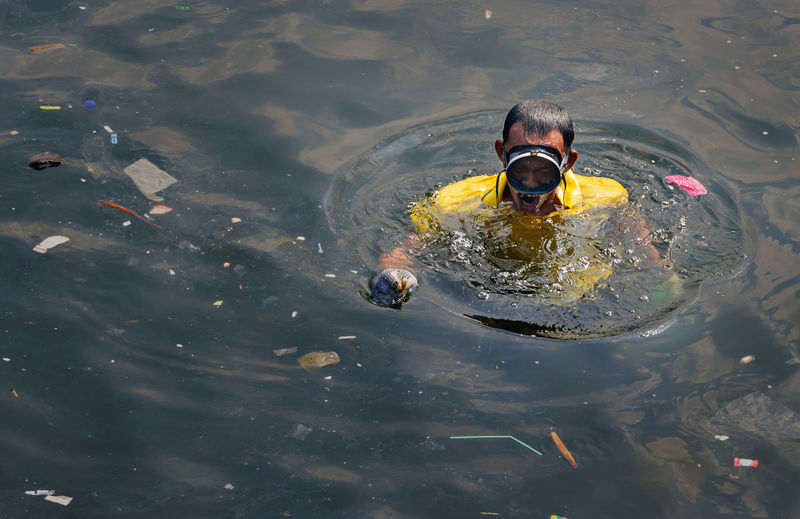 High angle view of man swimming in lake