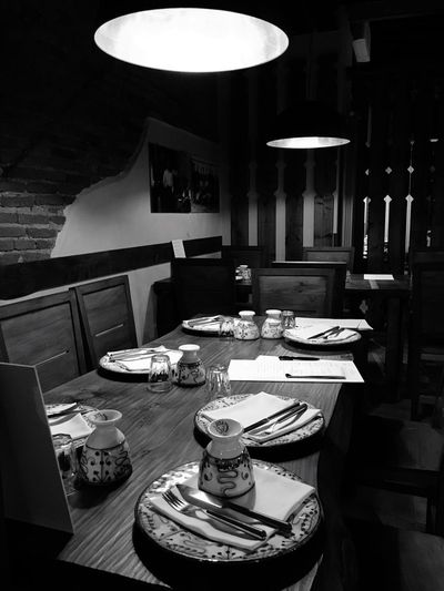 Osteria Porco-Maiale, Agrate Brianza, October 2017. Table Plate Indoors  No People Place Setting Chair Furniture Illuminated Restaurant Blackandwhite Lifestyles EyeEmNewHere Style Design Old Fashion