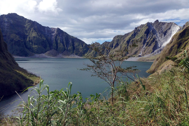 Mount Pinatubo Trekking Tour Crater Lake Philippines Travel Wanderlust Adventure Beauty In Nature Crater Day Lake Landscape Mount Pinatubo Mountain Nature No People Outdoors Range Scenery Scenics Sky Vegetation Volcanic Landscape Volcano Water Wilderness