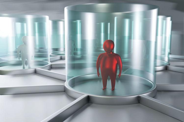 Rear view of man standing in illuminated corridor