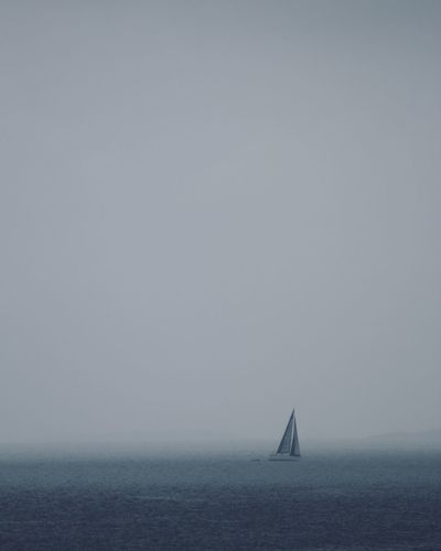 A Sailor sailing before storm. Abstract Archipelago Ocean Sailor Sailing Fog Rainy Season Cloudy Gray Weather Gray Water Sea Nautical Vessel Transportation Sailboat Mode Of Transportation Sky