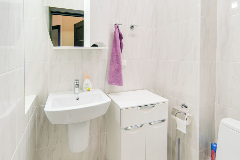 Bathroom Hygiene Domestic Bathroom Home White Color Domestic Room Sink Indoors  No People Household Equipment Tile Mirror Faucet Home Interior Towel Pink Color Architecture Flooring Bathroom Sink Domestic Life Luxury Clean
