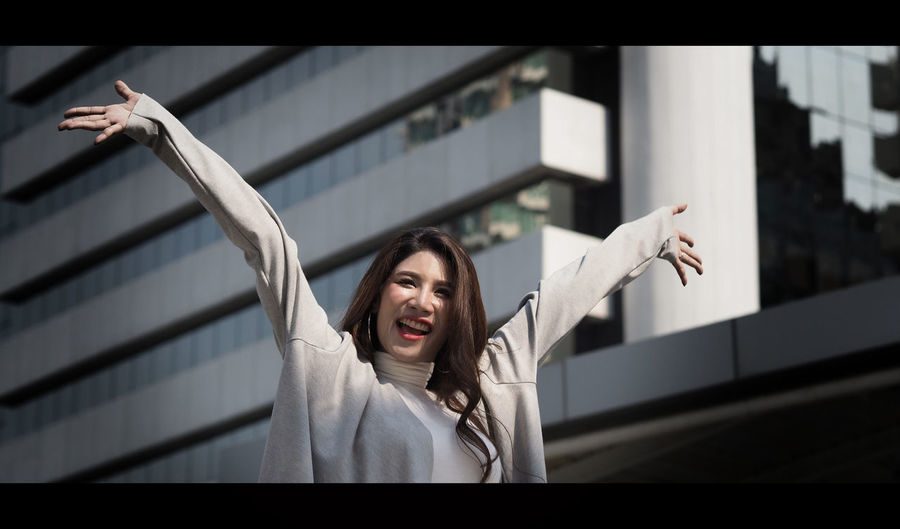 Beautiful asian business woman happy and cheerful or successful feeling with job which action like a winner by raise or lift up arms to the sky and shout yeah at outdoor city in summer season. One Person Real People Human Arm Women Portrait Lifestyles Arms Raised Emotion Indoors  Leisure Activity Adult Architecture Young Women Young Adult Headshot Front View Gesturing Railing Hairstyle Mouth Open Hand Raised Business; Woman; Happy; Success; Successful; People; Excited; Young; Female; Laptop; Businesswoman; Office; Winner; White; Background; Asian; Professional; Work; Computer; Person; Beautiful; Girl; Women; Win; Smile; Adult; Attractive; Arms; Caucasian; Che