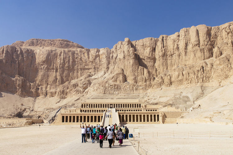 Tourists Walking Towards Temple Of Hatshepsut