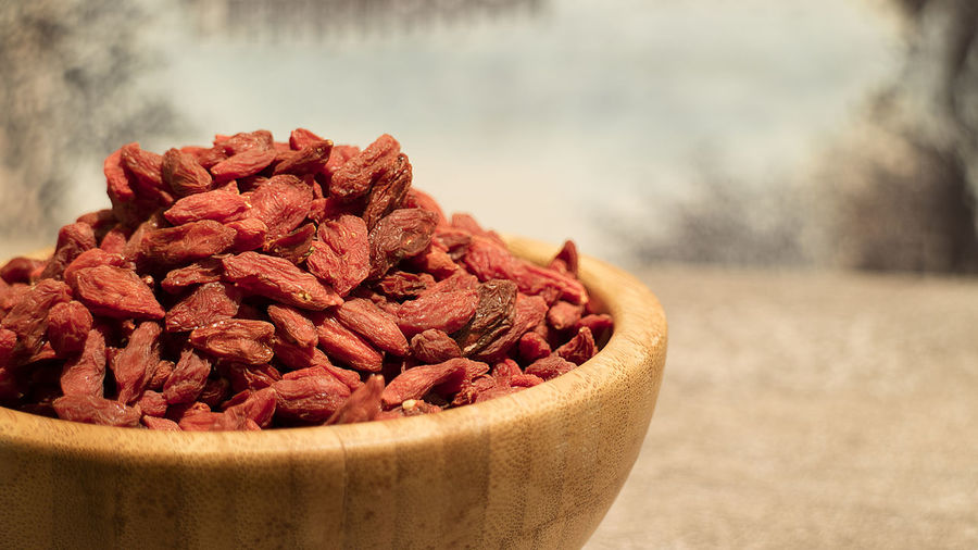 Close-up of gojis in wooden bowl