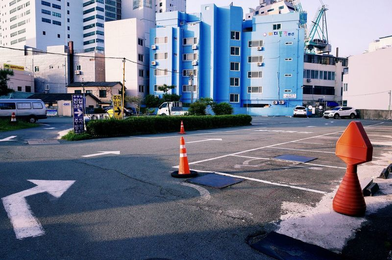 Architecture Building Building Exterior Built Structure Car City Cone Day Guidance Light Marking Mode Of Transportation Motor Vehicle No People Office Building Exterior Outdoors Road Road Marking Sign Street Symbol Traffic Cone Transportation