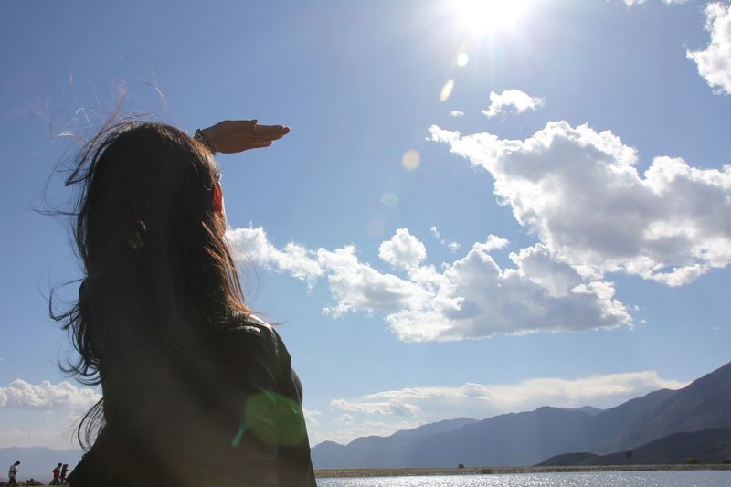 Woman Standing Against Sky