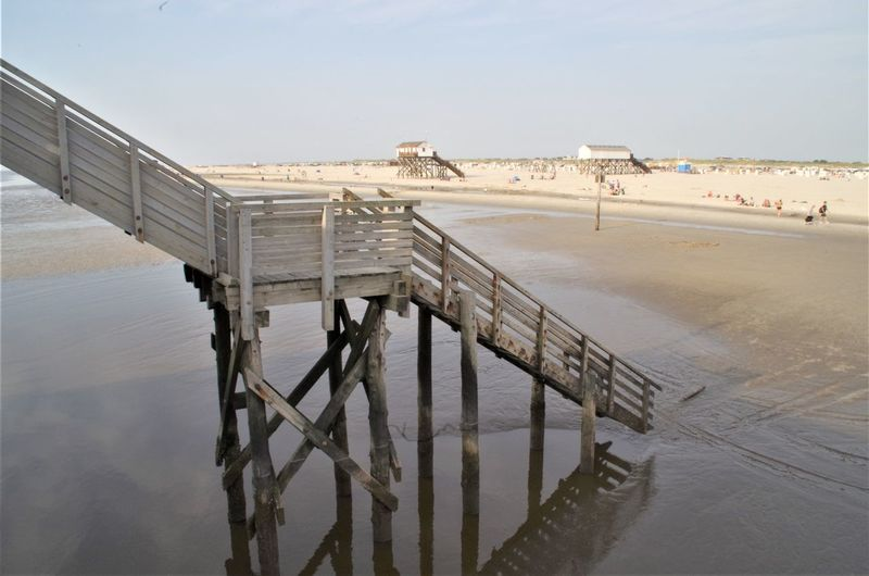 stairway to the beach St. Peter Ording Strandkorb Architecture Beach Building Exterior Built Structure Day High Angle View Land Nature No People Outdoors Pier Railing Reflection Salt Flat Sand Sea Sky Tranquil Scene Water Wood - Material