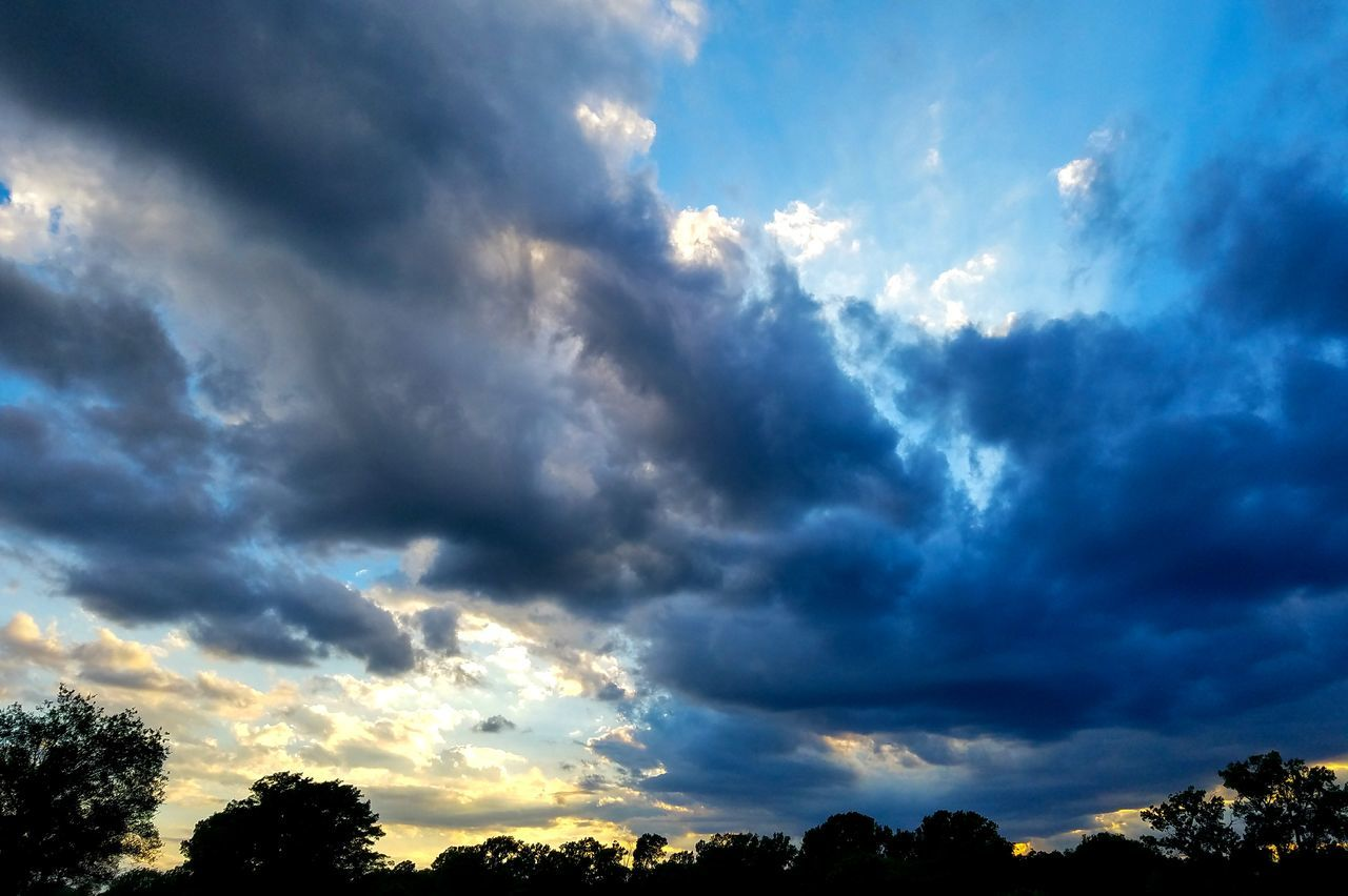 beauty in nature, sky, nature, cloud - sky, scenics, dramatic sky, tranquility, low angle view, tranquil scene, atmospheric mood, sunbeam, idyllic, no people, weather, tree, silhouette, sky only, outdoors, sunset, awe, blue, storm cloud, day