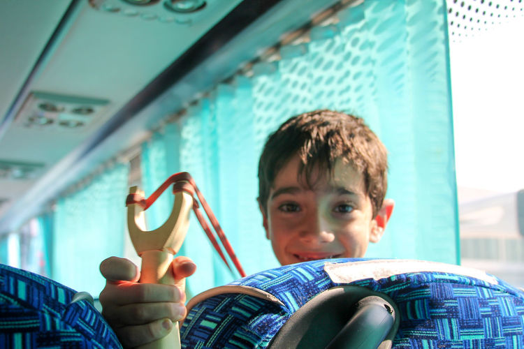 Catapult Child Childhood Children Only Close-up Headshot In The Bus Looking At Camera Low Angle View Portrait Slingshot Smiling Tweaker