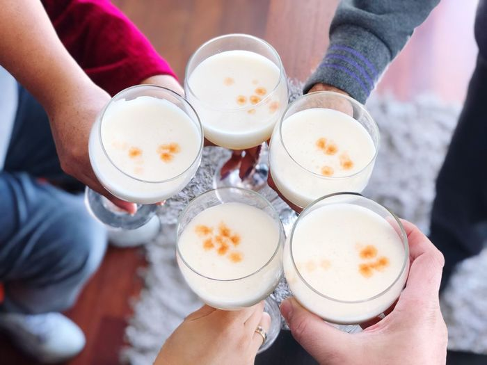 Pisco Sour Family Toast Piscosour Human Hand Hand Real People Human Body Part Drink Holding Food And Drink Refreshment Lifestyles Leisure Activity People High Angle View