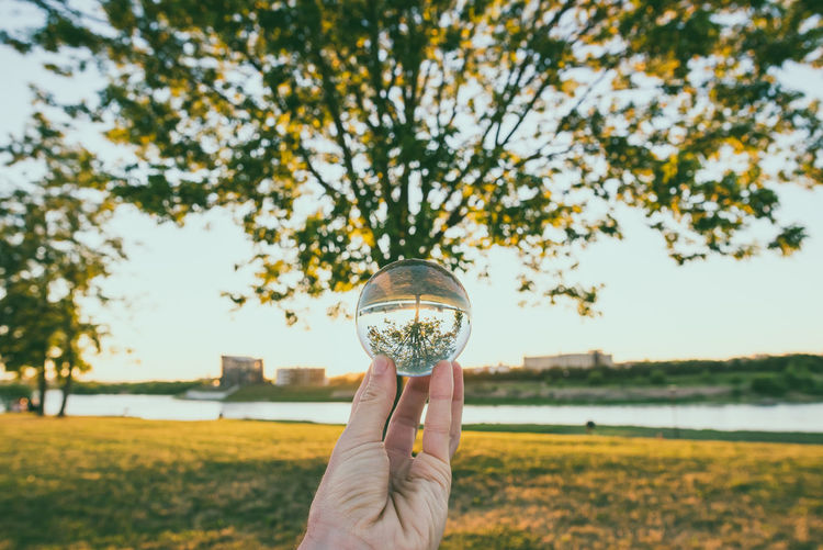 Upside down Beauty In Nature Close-up Crystal Ball Day Field Focus On Foreground Glass Ball Grass Holding Human Body Part Human Finger Human Hand Kaunas Old Town Lietuva Nature One Person Outdoors People Personal Perspective Real People Sky Tree Sommergefühle