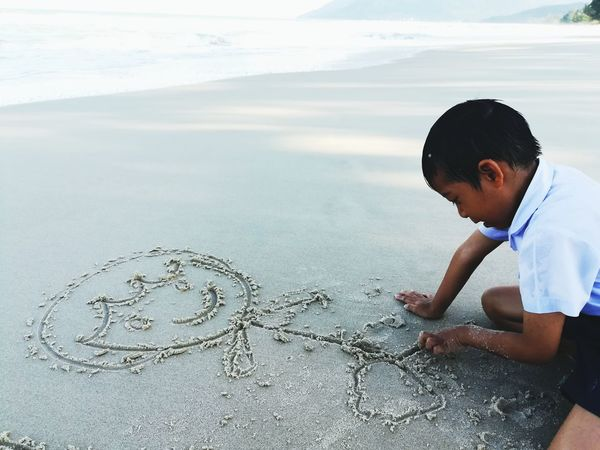 Boy Write On Sand Boy Playing Beach Sand & Sea Sand Beach Child Childhood Males  Beach Sand Standing Drawing - Activity