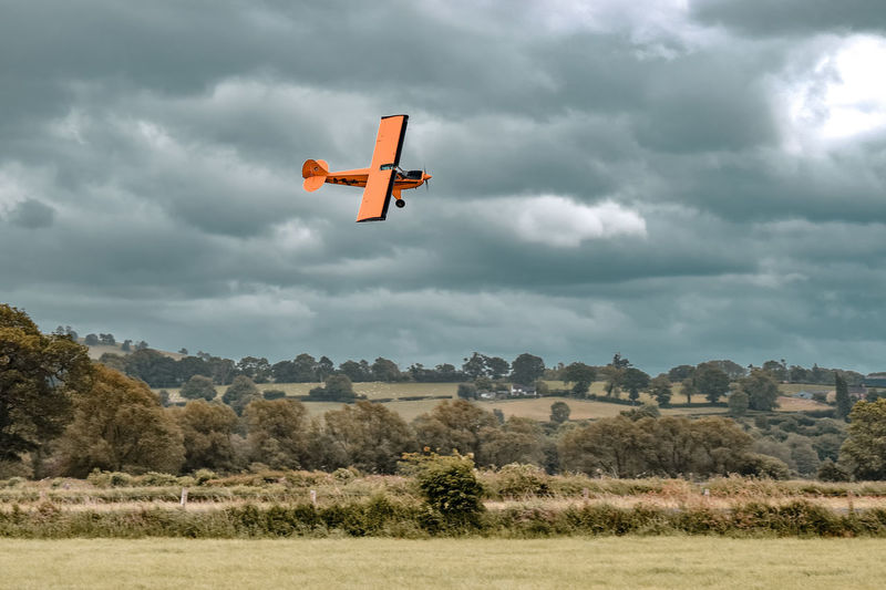 a little airplane Cloudy Orange Color Airfield Wales UK Turning Airplane Air Vehicle Flying Airshow Stunt RISK Competition Extreme Sports Danger Sport Accidents And Disasters Aerobatics Aircraft Wing Air Vehicle Airplane Wing Propeller Airplane Force Airplane Airport Runway Propeller