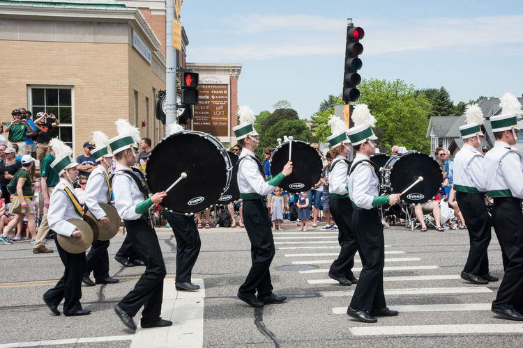 Naperville, Illinois, United States-May 29,2017: Waubonsie Valley High School marching in Memorial Day Parade with crowd in Naperville, Illinois Large Group Of People Crowd Street City March Marching Marching Band High School Students Waubonsie Valley In A Row Arts Culture And Entertainment Celebration Music Musical Instrument Parade Musician Performance Uniform Artist Drum Drumline Percussion Instrument Cymbal