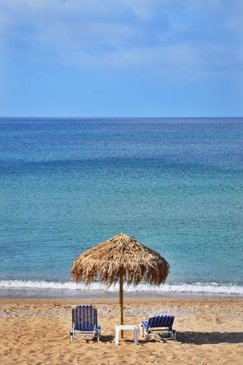 alone_time_beach. Horizon Sea And Sky Beach Photography Beachphotography Mediterranean Sea Shadow Place Corfu Agios Georgios Summer Landscape_photography Landscape_Collection Landscape Sea Water Beach Land Sky Parasol Beach Umbrella Sand Tranquil Scene Beauty In Nature Umbrella Sunshade Tranquility Shade Nature Horizon Over Water Chair