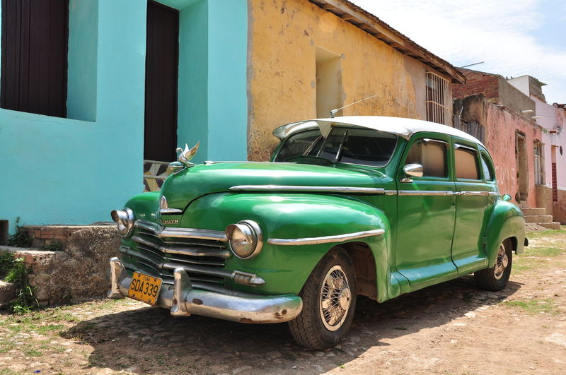 Havana, Cuba - April 28, 2010 Green Plymouth Oldtimer car in Havana the streets of a cuban city, in Cuba oldtimer cars are still in use because of the import limitations of goods Havana Havana, Cuba Steetphotography Car Classic Car Oldtimer Vintage Car Retro Styled City Tourism Outdoors