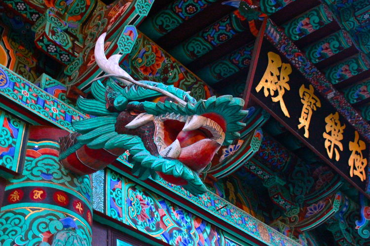 Low angle view of dragon statue on temple