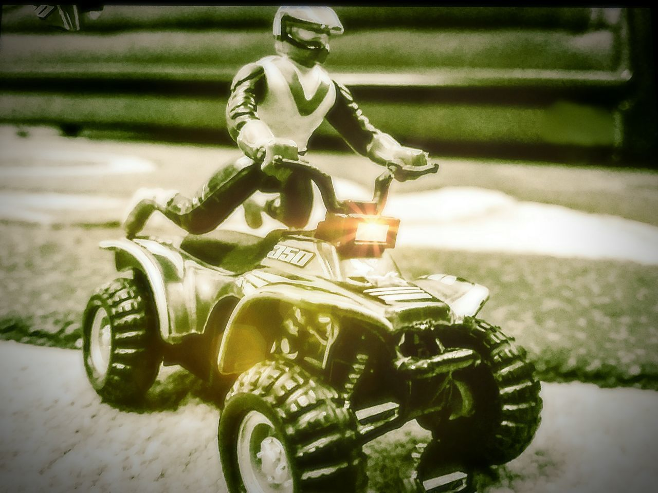 land vehicle, no people, close-up, toy car, stationary, outdoors, motorcycle, day, army