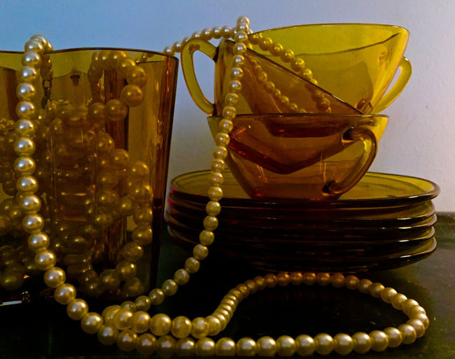 Arrangement Close-up Coffee Cups Coffee Time Day Design Elégance Fashion Fashion Photography Glass - Material Glass Objects  Gold Colored Indoors  Jewelry Luxury Necklace No People Pearl Jewelry Pearls Pearls And Coffee Still Life Still Life Photography Stillleben Vintage Presentation Background