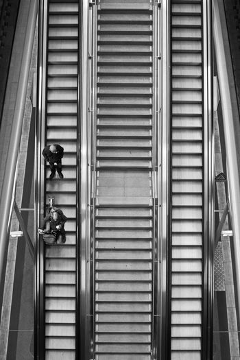 People On Escalator At Railroad Station