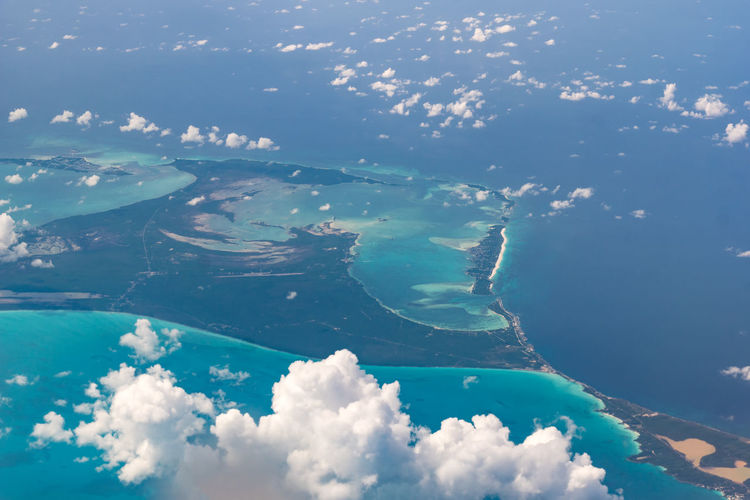Beautiful aerial view of the Bahamas islands - Spanish Wells - turquoise seas and interesting clouds Bahamas Aerial View Beauty In Nature Blue Cloud - Sky Day Environment Idyllic Island Land Nature No People Outdoors Scenics - Nature Sea Sky Spanish Wells Swimming Pool Tranquil Scene Tranquility Turquoise Colored Water Waterfront