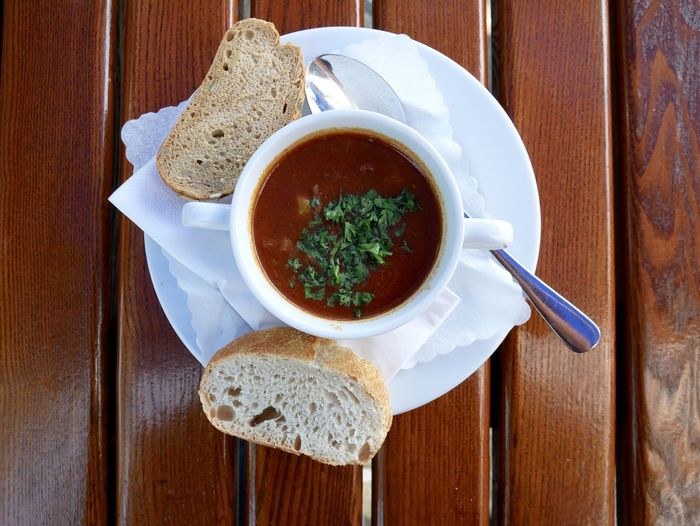 Goulash soup Goulash Soup Soup Of The Day Beer Garden Food Food And Drink Freshness Germany Goulash Gulaschsuppe Healthy Eating High Angle View Meal No People Ready-to-eat Serving Size Soup Soup Bowl Spoon Table Wood - Material