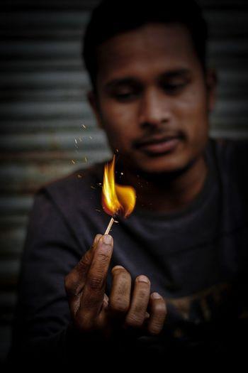 Man with burning matchstick