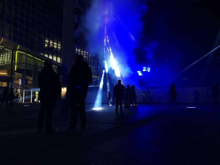People in the blue Smog Fog Blue Light Light Event Night Group Of People Illuminated Real People Crowd Architecture Lifestyles Arts Culture And Entertainment Event Silhouette City Lighting Equipment