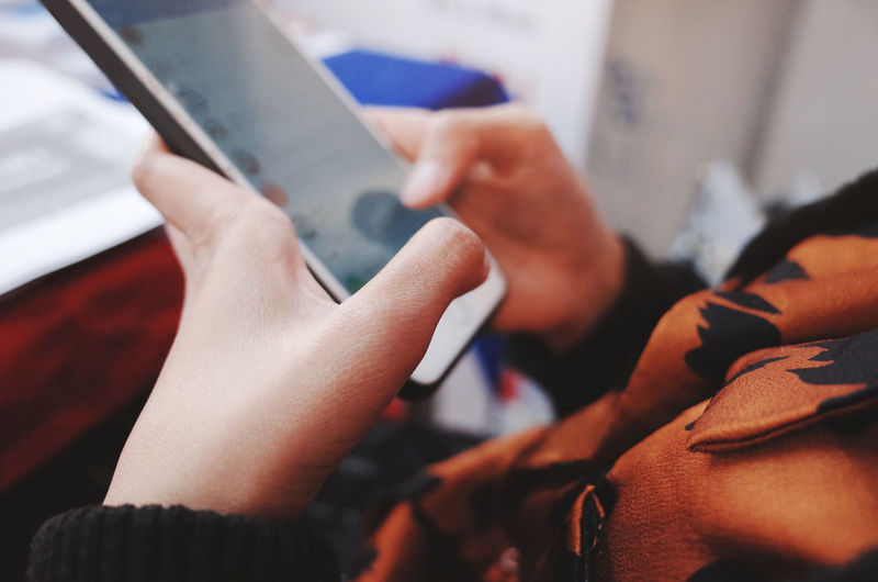 Wireless Technology Technology Real People Human Hand Communication One Person Connection Selective Focus Holding Human Body Part Lifestyles Digital Tablet Indoors  Hand Activity Women Adult Close-up Body Part Humanity Meets Technology