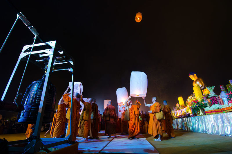 15 may 2014, Magelang, Indonesia : Participants releasing lanterns over the Borobudur temple in Magelang, Central Java during Vesak/Waisak Day celebrations Architecture Arts Culture And Entertainment Belief Built Structure Crowd Group Of People Illuminated Lifestyles Light Men Night People Real People Rear View Religion Spirituality Stage Traditional Clothing Women